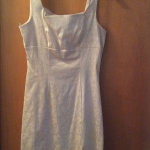 White brocade empire mini dress w/side slit.